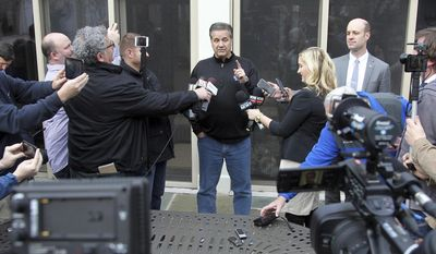 Kentucky head coach John Calipari, makes a point to the media in his backyard after viewing the NCAA basketball selection show at his home, Sunday, March 12, 2017, in Lexington, Ky. (AP Photo/James Crisp)