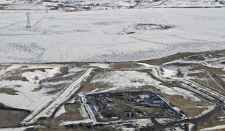 FILE - This Feb. 13, 2017, aerial file photo, shows a site where the final phase of the Dakota Access pipeline is taking place with boring equipment routing the pipeline underground and across Lake Oahe to connect with the existing pipeline in Emmons County near Cannon Ball, N.D. Federal Judge James Boasberg on Tuesday, March 14 denied a request by the Standing Rock and Cheyenne River Sioux to stop oil from flowing while they appeal his earlier decision allowing pipeline construction to finish. (Tom Stromme/The Bismarck Tribune via AP, File)