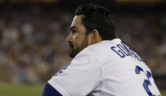 FILE - This Oct. 20, 2016 file photo shows Los Angeles Dodgers' Adrian Gonzalez watching from the dugout during the seventh inning of Game 5 of the National League baseball championship series against the Chicago Cubs in Los Angeles. Gonzalez  Gonzalez had some harsh words, Wednesday, March 15, 2017, for organizers of the World Baseball Classic, saying 'they're not even close to being the Little League World Series'. (AP Photo/David J. Phillip)