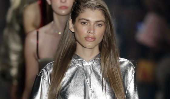 Brazilian transgender model Valentina Sampaio wears a creation from the Amir Slama collection during Sao Paulo Fashion Week in Sao Paulo, Brazil, Thursday, March 16, 2017. (AP Photo/Andre Penner)