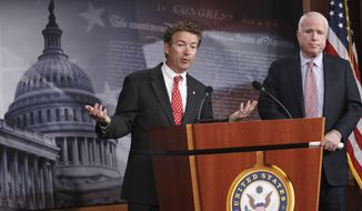 FILE - In this Oct. 13, 2011 file photo, Sen. Rand Paul, R-Ky., left, accompanied by Sen. John McCain, R-Ariz., gestures during a news conference on Capitol Hill in Washington. Paul has called fellow Republican McCain a little bit unhinged after McCain said the senator from Kentucky is now working for Vladimir Putin. (AP Photo/Manuel Balce Ceneta, File)