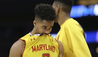 Maryland guard Melo Trimble is shown during the last seconds of the second half of the first round of the NCAA college basketball tournament, Thursday, March 16, 2017 in Orlando, Fla. Xavier defeated Maryland 76-65. (AP Photo/Gary McCullough)