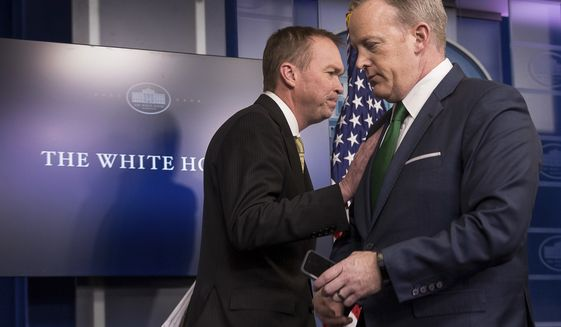 White House press secretary Sean Spicer, right, give the podium to Budget Director Mick Mulvaney during daily press briefing at the White House in Washington, Thursday, March 16, 2017, where he spoke about the Trump Administration's budget proposals. (AP Photo/Andrew Harnik)