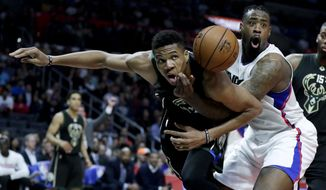 Los Angeles Clippers center DeAndre Jordan, right, reacts after fouling Milwaukee Bucks forward Giannis Antetokounmpo during the second half of an NBA basketball game in Los Angeles, Wednesday, March 15, 2017. The Bucks won 97-96. (AP Photo/Chris Carlson)