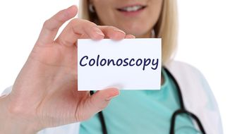 Colonoscopy cancer prevention screening check-up disease ill illness nurse doctor with sign