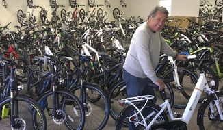 In a March 8, 2017 photo, Len Mattioli's current 4,000-square-foot store, Crazy Lenny's E-Bikes, on Odana Road, in Madison is crammed with electric bikes, leaving little room for customers or service technicians. Mattioli's new showroom, a 12,000-square-foot space, offers three times the space than his current location. (Barry Adams/Wisconsin State Journal via AP)