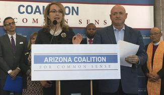 Former Arizona Congresswoman Gabby Giffords and retired astronaut Capt. Mark Kelly speak to reporters in Phoenix, Ariz. on Thursday, March 16, 2017, about a new Arizona group focused on passing gun safety legislation. Giffords was gravely wounded during a mass shooting in Tucson in 2011 that left six dead and 13, including Giffords, injured. (AP Photo/Astrid Galvan)
