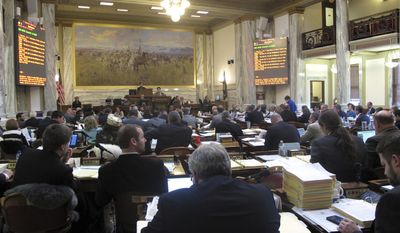 Legislators in the Montana House debate the 2018-2019 state budget Thursday, March 16, 2017, in Helena, Mont.   Democrats in the Montana House had one last chance Thursday to try to add money to the state budget for programs in education and health and human services during a floor debate on the two-year spending plan.  (AP Photo/Matt Volz)