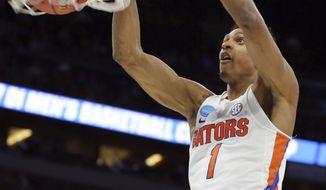Florida forward Devin Robinson dunks against East Tennessee State during the first half of a first-round men's college basketball game in the NCAA Tournament, Thursday, March 16, 2017, in Orlando, Fla. (AP Photo/Gary McCullough)