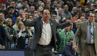 Notre Dame coach Mike Brey yells to players during the second half of a first-round men's college basketball game in the NCAA Tournament against Princeton, Thursday, March 16, 2017, in Buffalo, N.Y. (AP Photo/Jeffrey T. Barnes)