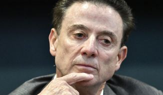 FILE- In this Oct. 20, 2016, file photo, Louisville basketball coach listens to a response during a news conference about an NCAA investigation, in Louisville, Ky. Pitino is portraying this season as a comeback story at Louisville--proud of what his team has accomplished after losing two scholarships as part of self-imposed sanctions that also included missing the postseason last year. The coach has accused the NCAA of overreaching for suggesting a possible one-year suspension because he failed to monitor an assistant coach who hired female escorts to party with recruits. (AP Photo/Timothy D. Easley, File)