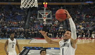 Villanova guard Jalen Brunson (1) drives to the basket against Mount St. Mary's guard Junior Robinson (0) during the first half of a first-round men's college basketball game in the NCAA Tournament, Thursday, March 16, 2017, in Buffalo, N.Y. (AP Photo/Bill Wippert)
