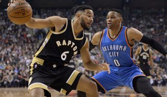 Toronto Raptors guard Cory Joseph (6) tries to drive for the net past Oklahoma City Thunder guard Russell Westbrook (0) during the first half of an NBA basketball game Thursday, March 16, 2017, in Toronto. (Nathan Denette/The Canadian Press via AP)