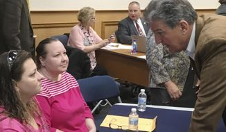 U.S. Sen. Joe Manchin, D-W.Va., speaks with Diane Hughes and Stephanie Frederiksen at a Town Hall meeting, Thursday, March 16, 2017, in Martinsburg, W.Va., focused on the possible loss of health coverage under the proposed House Republican replacement for the Affordable Care Act. Both women said they got badly needed treatment under the current law. (AP Photo/Michael Virtanen)
