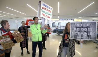 Protestors chant in Terminal B at the Newark International Airport prior to addressing the media, in Newark, NJ., Thursday March 16, 2017. A diverse group of advocates and immigrant New Jerseyans gathered to condemn Trump's updated travel ban. (Aristide Economopoulos/NJ Advance Media via AP)