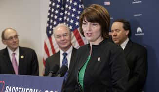 "Rep. Cathy McMorris Rodgers, R-Wash., chair of the Republican Conference, center, joined by, from left, Rep. Phil Roe, R-Tenn., Health and Human Services Secretary Tom Price, and Rep. Pat Tiberi, R-Ohio, speaks during a news conference on Capitol Hill in Washington, Friday, March 17, 2017, as House Republicans push for unity in advancing the GOP's ""Obamacare"" replacement bill. (AP Photo/J. Scott Applewhite)"