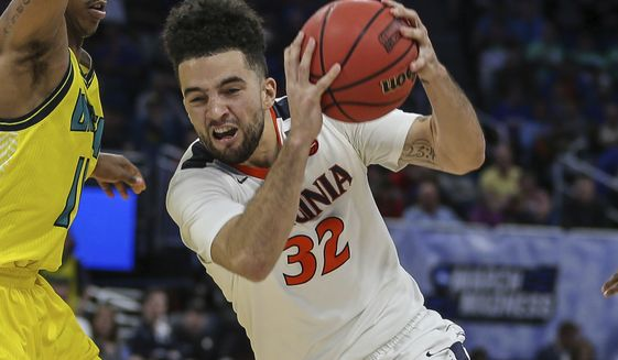 Virginia guard London Perrantes (32) drives to the basket during the second half of the first round of the NCAA college basketball tournament, Thursday, March 16, 2017 in Orlando, Fla. (AP Photo/Gary McCullough)