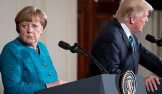 President Donald Trump and German Chancellor Angela Merkel participate in a joint news conference in the East Room of the White House in Washington, Friday, March 17, 2017. (AP Photo/Andrew Harnik)
