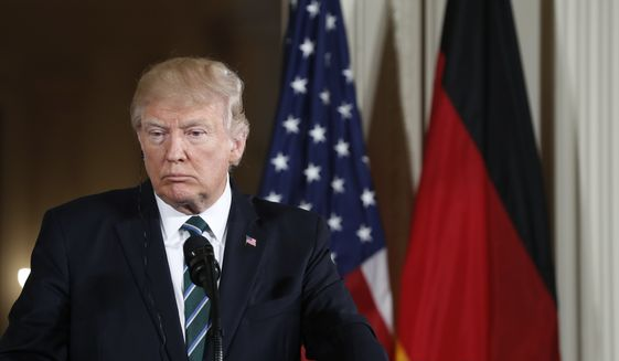 President Donald Trump listens to a question during a joint news conference with German Chancellor Angela Merkel in the East Room of the White House in Washington, Friday, March 17, 2017. (AP Photo/Pablo Martinez Monsivais)