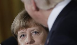 German Chancellor Angela Merkel listens as President Donald Trump speaks during a joint news conference in the East Room of the White House in Washington, Friday, March 17, 2017.(AP Photo/Evan Vucci)