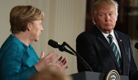 President Donald Trump looks to German Chancellor Angela Merkel as she speaks during a joint news conference in the East Room of the White House in Washington, Friday, March 17, 2017. (AP Photo/Andrew Harnik)