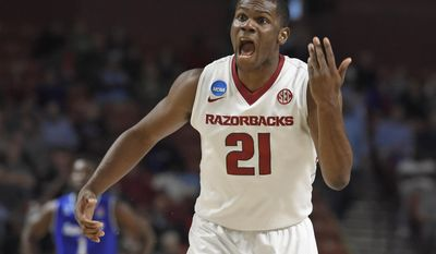 Arkansas's Manuale Watkins (21) argues a call during the second half in a first-round game of the NCAA men's college basketball tournament against Seton Hall in Greenville, S.C., Friday, March 17, 2017. (AP Photo/Rainier Ehrhardt)