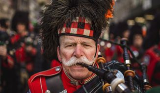 Bagpipers march up  Fifth Avenue during the St. Patrick's Day Parade, Friday, March 17, 2017, in New York.  New York City was awash in green and Irish pride as throngs celebrated at the annual parade. (AP Photo/Andres Kudacki)