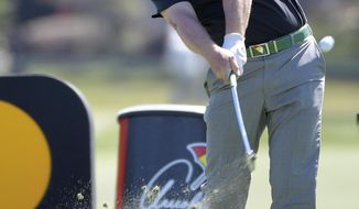 Charley Hoffman tees off on the 14th hole during the second round of the Arnold Palmer Invitational golf tournament in Orlando, Fla., Friday, March 17, 2017. (AP Photo/Phelan M. Ebenhack)