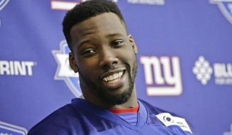 FILE - In this April 26, 2016, file photo, New York Giants' Jason Pierre-Paul smiles as he talks to reporters after an NFL football minicamp practice in East Rutherford, N.J. Star defensive end Jason Pierre-Paul has signed a four-year contract with the New York Giants. The team gave Pierre-Paul the franchise tag last month, and reached the long-term deal Friday, March 17, 2017.(AP Photo/Frank Franklin II, File)