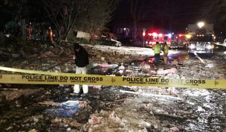 "In this photo provided by the Montgomery County fire & Rescue Service, emergency personnel work at the scene of a leveled house in Rockville, Md., Friday, March 17, 2017. Authorities said the explosion occurred about 1 a.m. Friday and reduced the home to a ""pile of bricks."" (Montgomery County fire & Rescue Service via AP)"