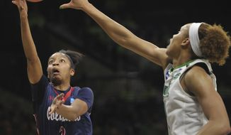Robert Morris' Nia Adams drives to the basket against Notre Dame's Brianna Turner during a first-round game in the NCAA college basketball tournament Friday, March 17, 2017, in South Bend, Ind. (Pam Panchak/Pittsburgh Post-Gazette via AP)