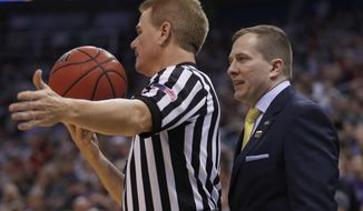 South Dakota State head coach T.J. Otzelberger talks to an official during the second half of a first-round men's college basketball against against the Gonzaga in the NCAA Tournament Thursday, March 16, 2017, in Salt Lake City. Gonzaga defeated South Dakota State 66-46. (AP Photo/George Frey)