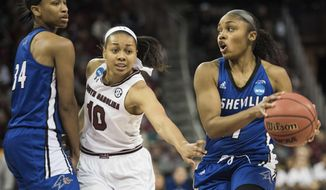North Carolina Asheville guard Khaila Webb (11), with North Carolina Asheville center Bronaza Fitzgerald (34), drives to the hoop against South Carolina guard Allisha Gray (10) during a first-round game in the women's NCAA college basketball tournament Friday, March 17, 2017, in Columbia, S.C. (AP Photo/Sean Rayford)