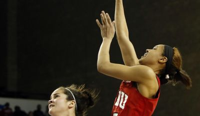 Western Kentucky's Kyvin Goodin-Rogers, right, shoots while defended by Ohio State's Makayla Waterman, left, during a first-round game in the women's NCAA college basketball tournament in Lexington, Ky., Friday, March 17, 2017. Ohio State won 70-63. (AP Photo/James Crisp)