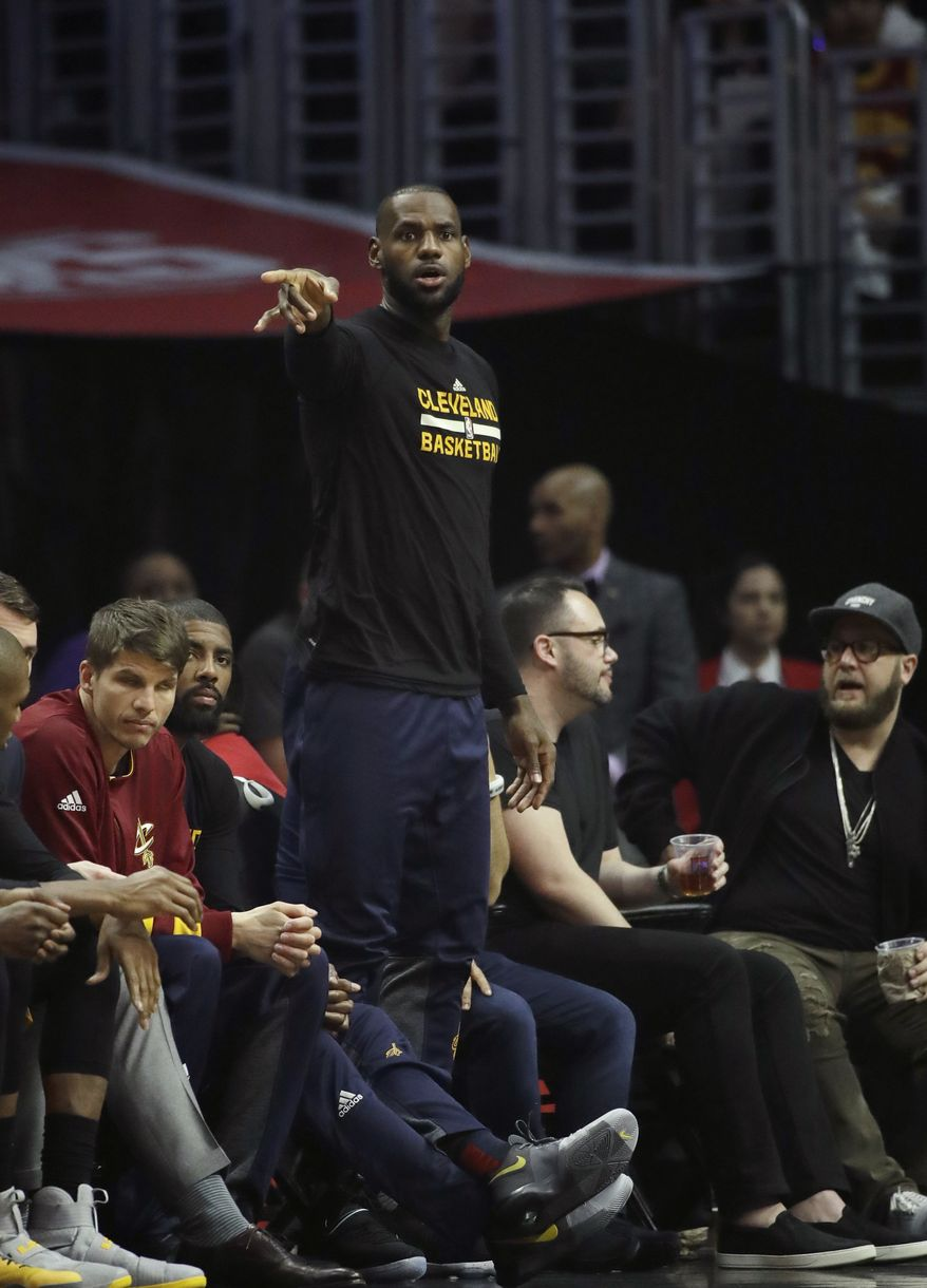 Cleveland Cavaliers' LeBron James watches from the bench during the first half of an NBA basketball game against the Los Angeles Clippers, Saturday, March 18, 2017, in Los Angeles. (AP Photo/Jae C. Hong) **FILE**