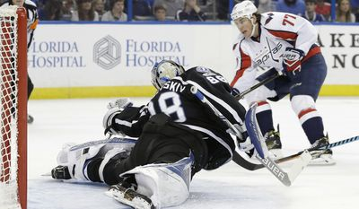 Tampa Bay Lightning goalie Andrei Vasilevskiy (88) cannot reach a shot as Washington Capitals right wing T.J. Oshie (77) scores a goal during the first period of an NHL hockey game Saturday, March 18, 2017, in Tampa, Fla. (AP Photo/Chris O'Meara)
