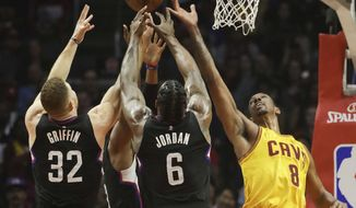 Cleveland Cavaliers' Channing Frye, right, fights for a rebound with Los Angeles Clippers' Blake Griffin and DeAndre Jordan during the first half of an NBA basketball game Saturday, March 18, 2017, in Los Angeles. (AP Photo/Jae C. Hong)