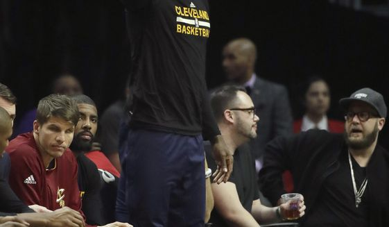Cleveland Cavaliers' LeBron James watches from the bench during the first half of an NBA basketball game against the Los Angeles Clippers, Saturday, March 18, 2017, in Los Angeles. (AP Photo/Jae C. Hong)