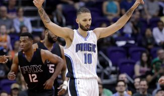 Orlando Magic guard Evan Fournier (10) celebrates after a basket against the Phoenix Suns during the second half of an NBA basketball game, Friday, March 17, 2017, in Phoenix. (AP Photo/Matt York)
