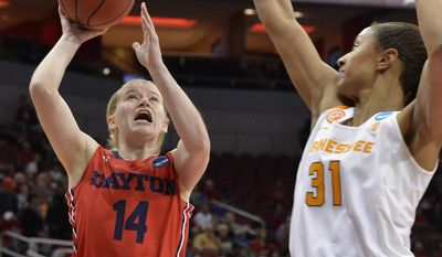 Dayton's Jenna Burdette (14) shoots over the defense of Tennessee's Jaime Nared (31) in the first half of a first-round game in the women's NCAA college basketball tournament, Saturday, March 18, 2017, in Louisville, Ky. (AP Photo/Timothy D. Easley)