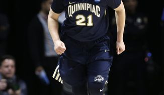 Quinnipiac forward Jen Fay (21) reacts after shooting a three-point basket during the first half of a first round game against Marquette in the NCAA women's college basketball tournament, Saturday, March 18, 2017, in Coral Gables, Fla. (AP Photo/Lynne Sladky)