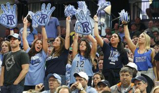 Rhode Island fans cheer for their team against Creighton during a first-round game in the NCAA college basketball tournament in Sacramento, Calif., Friday, March 17, 2017. Rhode Island won 84-72. (AP Photo/Steve Yeater)