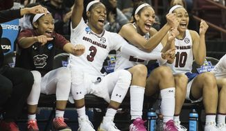 South Carolina guard Tyasha Harris, left, Kaela Davis (3), A'ja Wilson, second from right, and Allisha Gray (10) celebrate a basket against North Carolina Asheville during a first-round game in the women's NCAA college basketball tournament Friday, March 17, 2017, in Columbia, S.C. South Carolina defeated UNC Asheville 90-40. (AP Photo/Sean Rayford)