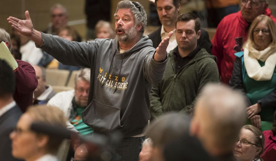 Paul Bellinger reacts to an answer U. S. Senator Ben Sasse gave during a town hall meeting Friday, March 17, 2017, in Omaha, Neb.   (Ryan Soderlin/Omaha World-Herald via AP)