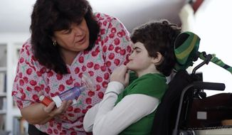 In-home nurse Jane Kern, left, chats with her patient Lexi Gerkin while administering medication at the Gerkin family home in Brentwood, N.H., Friday, March 17, 2017. Pressed by parents of severely sick children, New Hampshire increased Medicaid reimbursement rates for skilled in-home nurses a year ago. But while some families report improvements, the number of shifts being filled has barely budged. (AP Photo/Charles Krupa)