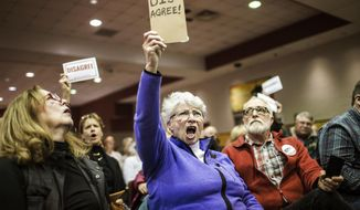 Audience members show their disapproval during a town hall event hosted by Republican U.S. Rep. Scott Perry at a Junior High School in Red Lion, Pa., on Saturday, March 18, 2017.   Perry is the first Pennsylvania Republican member of Congress to hold a live town hall since Trump took office. Submitted questions are being picked and read by the school district's superintendent.  (Sean Simmers/PennLive.com via AP)