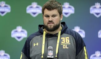 FILE - In this March 2, 2017 file photo, Wisconsin offensive lineman Ryan Ramczyk speaks during a news conference at the NFL football scouting combine in Indianapolis. NFL teams have to project how shrewdly and swiftly the new prospects will adjust to the pro game because most of them have never gotten into a three-point stance to blow his opponent off the ball or been asked to maintain a block for several seconds while his quarterback searches for his target. (AP Photo/David J. Phillip)