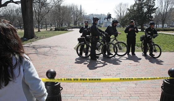 U.S. Secret Service officers stand in the cordoned off Lafayette Park after a security incident near the fence of the White House in Washington, Saturday, March 18, 2017. President Trump was not at the White House at the time of the incident. (AP Photo/Alex Brandon)