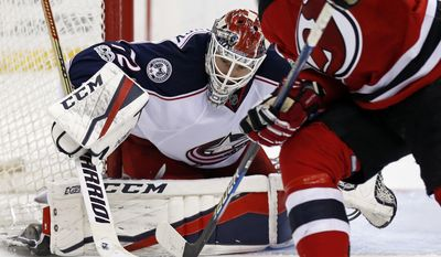 Columbus Blue Jackets goalie Sergei Bobrovsky (72) makes a save on a shot by New Jersey Devils right wing Kyle Palmieri (21) during the second period of an NHL hockey game, Sunday, March 19, 2017, in Newark, N.J. (AP Photo/Adam Hunger)