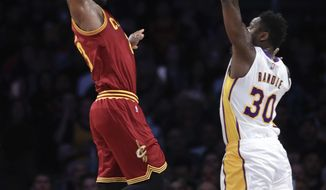 Cleveland Cavaliers' LeBron James, left, goes up for a dunk under defense by Los Angeles Lakers' Julius Randle during the first half of an NBA basketball game Sunday, March 19, 2017, in Los Angeles. (AP Photo/Jae C. Hong)